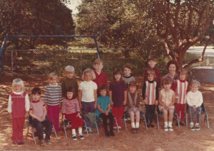 Me in preschool I am the forth one from the left in the striped shirt with an insect in my pocket no doubt.